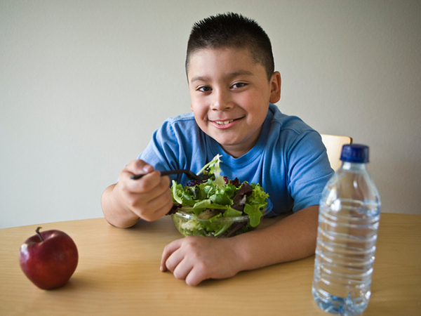 kid eating a salad