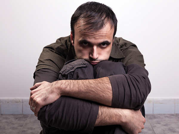 man wrapping arms around legs