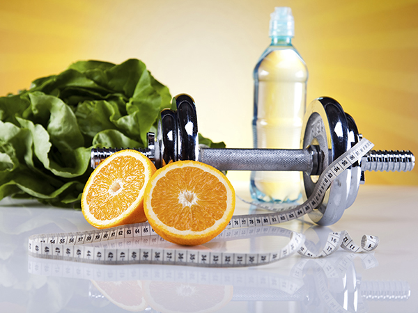 weights, oranges, water and lettuce