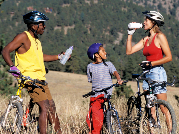 kid and parent bike riding - 19 Easy Ways to Encourage Your Kids to Get Active