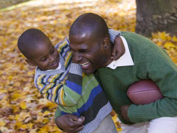 Father and Son Playing Football - Family Exercise Ideas for Every Season
