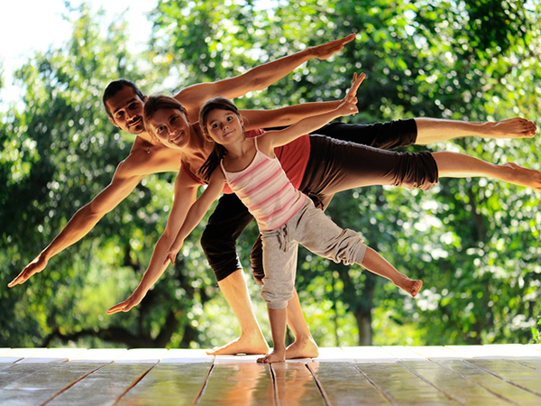 Family doing yoga together - 30-Minute Workouts for Any Schedule