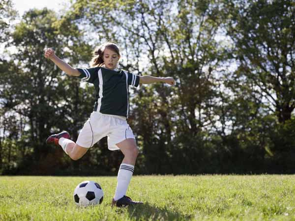 Girl Playing Soccer - Teen Nutrition for Fall Sports