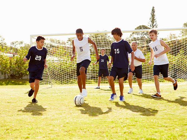 Gameday Nutrition Tips for Young Athletes - Young Boys Playing Soccer