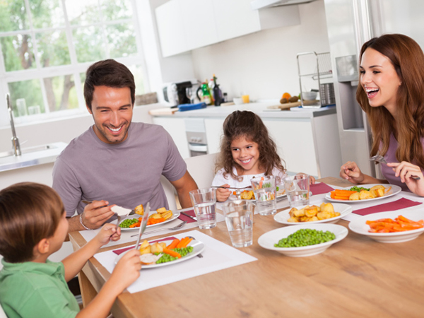 Family enjoying a healthy meal together - Make Your Kid's Meal a MyPlate Superstar