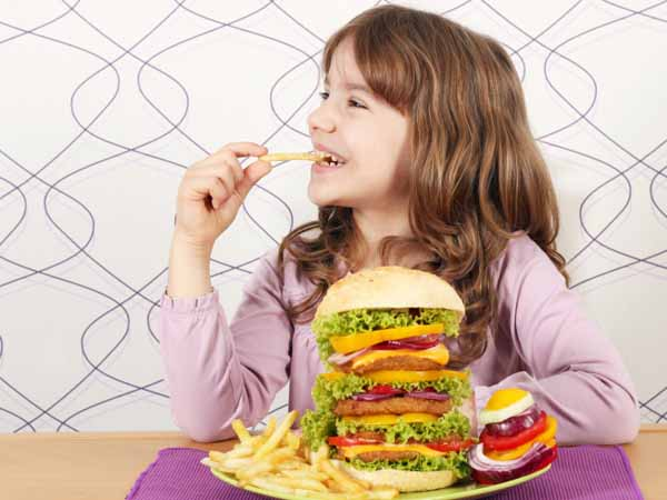 Young Girl with Oversized Burger - Kids and Portion Control