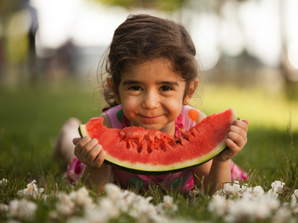 Girl enjoying summer watermelon - Summer Is Time for Kids to Try New Foods
