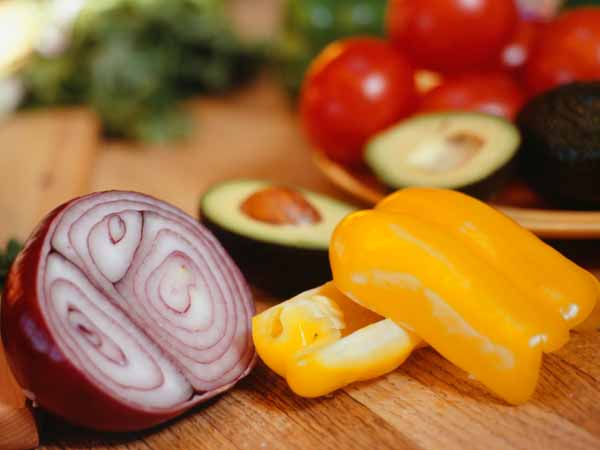 sliced onion, peppers and avocado - Tilapia and Sautéed Peppers in Soft Tacos Recipe