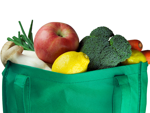 reusable grocery bag full of food - 6 Tips to Lighten Your Carbon Foodprint