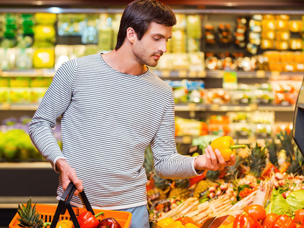 Man Shopping for Produce - 7 Ways to Shop Healthy on a Budget