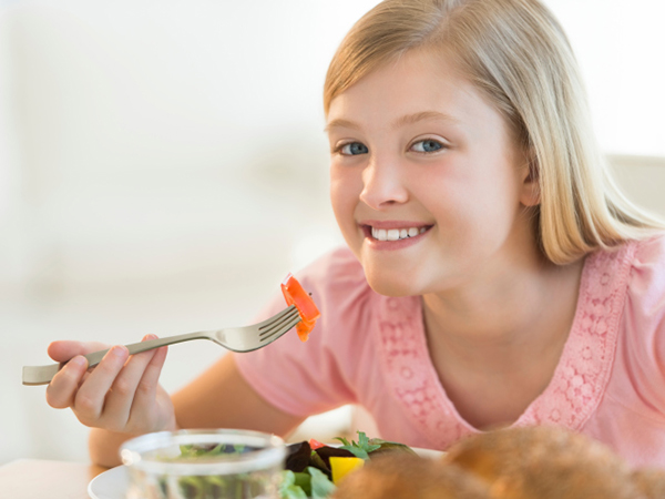 Girl Eating Vegetables - 5 Foods Your Kids Will Love