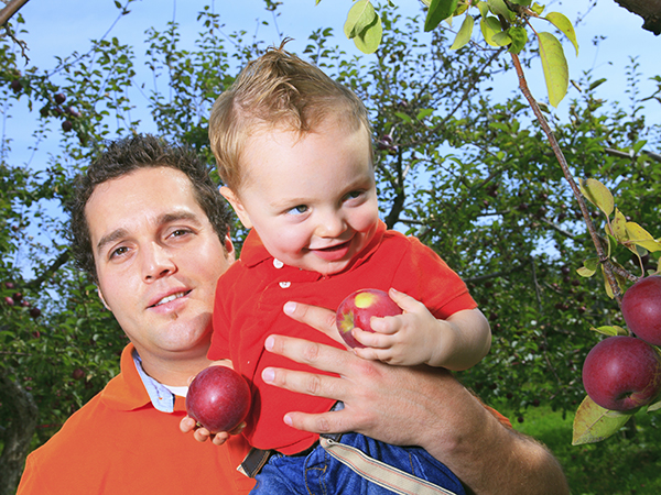 dad holding baby at apple orchard -  Kidney Disease: High- and Moderate-Potassium Foods