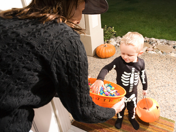 Young child trick-or-treating - 7 Ways to Make Halloween Safer for Kids with Food Allergies