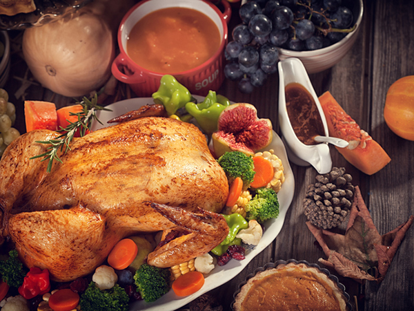 holding golden turkey - Make Holiday Meals Healthier with a Leaner Menu
