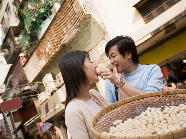 Couple Eating Outside - Food Safety Tips for Traveling Abroad