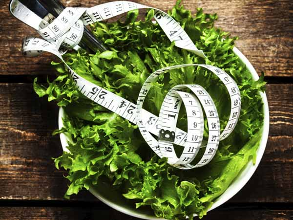 bowl of lettuce and measuring tape - Staying Away from Fad Diets