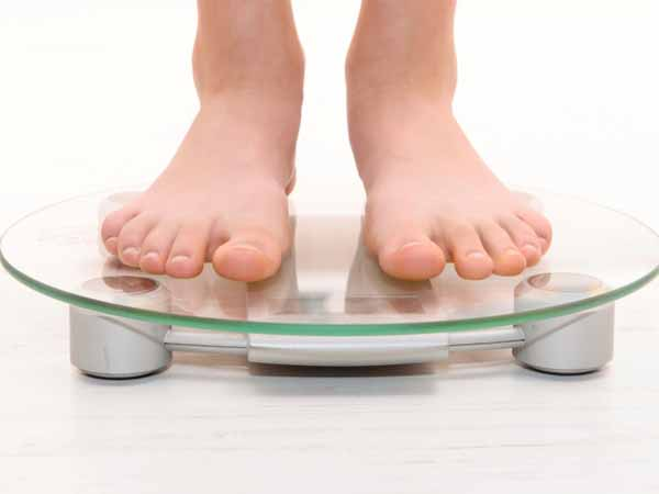 Standing on the Scale - 4 Ways to Shed the Weight for Good