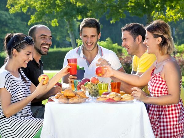 Friends enjoying a picnic - 5 Ways Low-Calorie Diets Can Sabotage Your Health