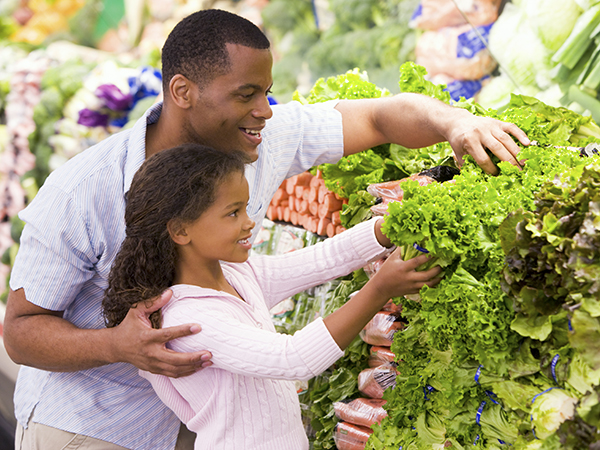 Dad and Daughter Selecting the Best Veggies to Keep Dad Healthy