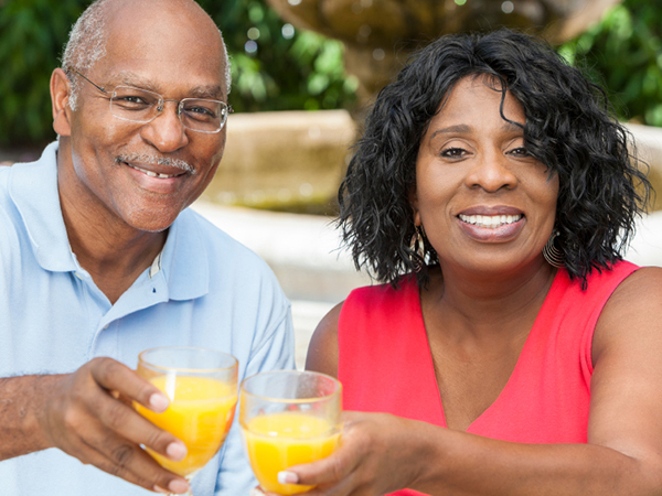couple drinking orange juice - Top Foods for a Healthy Heart