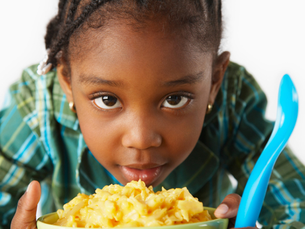 Child and mac-and-cheese