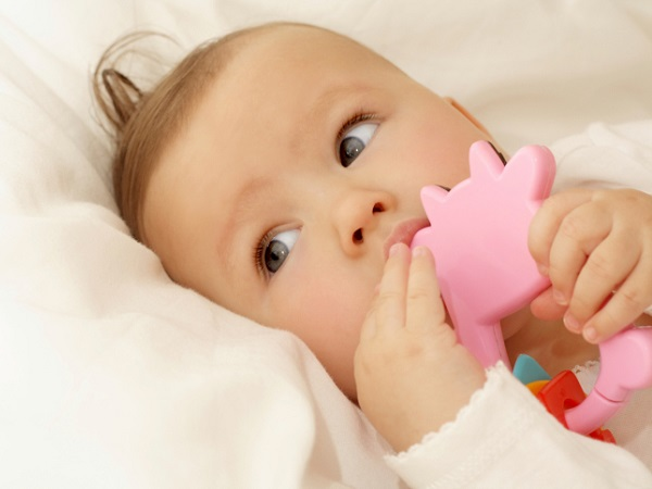 Baby chewing on a teething ring - Reliving the Discomforts of Teething