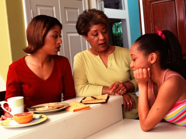 women talking to teen about breakfast