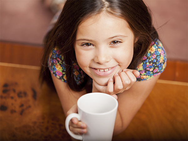 kid holding coffee mug