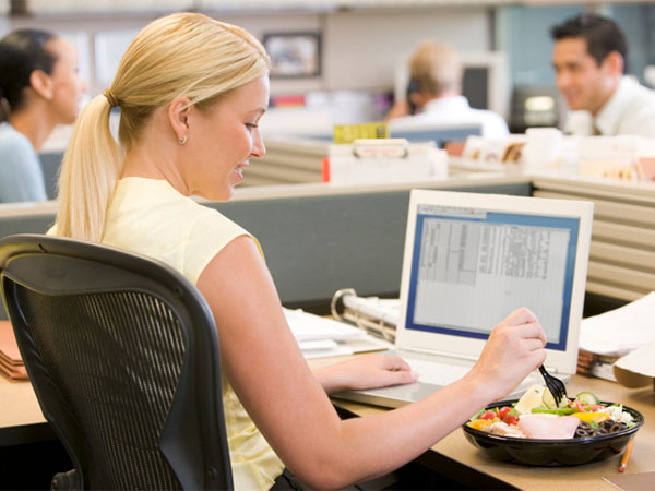 woman eating at desk - Desktop Dining