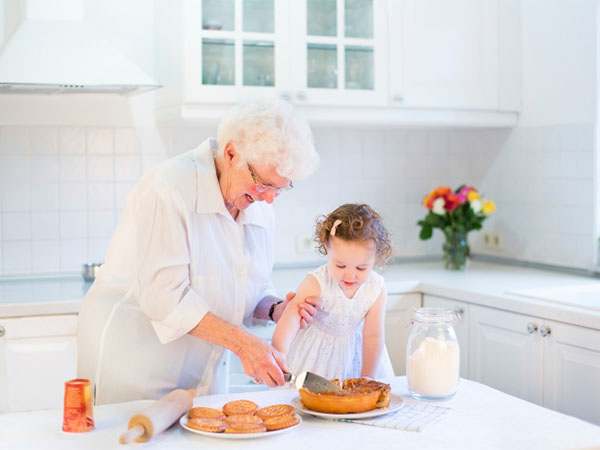 grandma and granddaughter baking