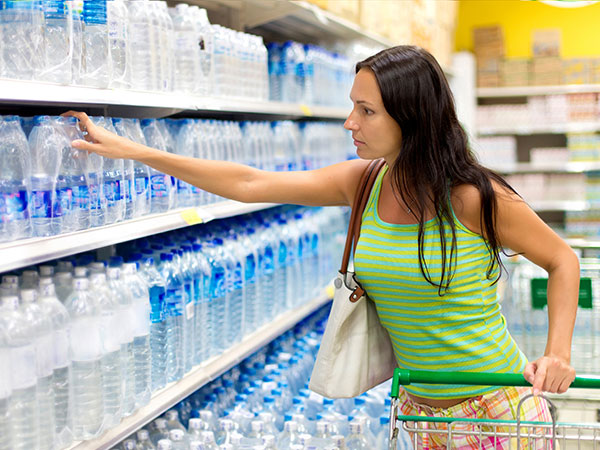 Woman buying water | Preparing for a Natural Disaster