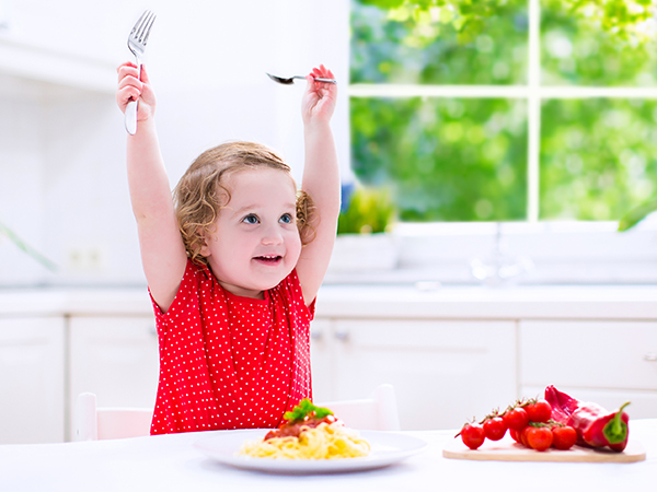 Little girl happy for dinner - 8 Ways to Get Picky Eaters to Become More Adventurous