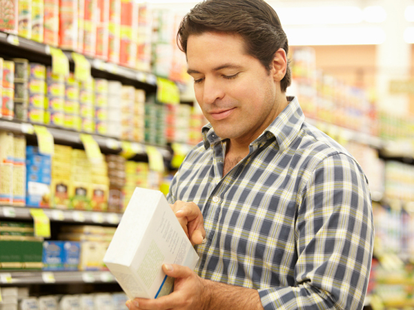 Man reading a food label - The Basics of the Nutrition Facts Panel