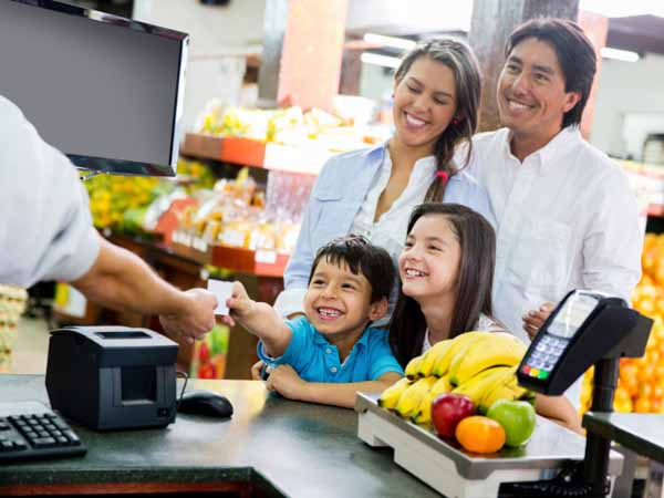 Family Checking Out at Supermarket - Budget-Friendly Tips to Feed Your Family of 4 for $20