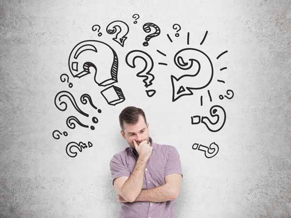 man pondering questions - 7 Most Asked Questions About National Nutrition Month