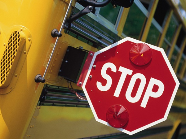 Stop sign on a school bus - How to Keep Your Food-Allergic Child Safe at School