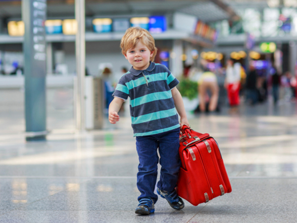 Boy is ready for his flight - 5 Food Tips for Traveling with Kids