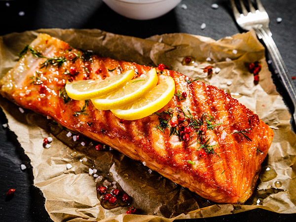 Grilled salmon on paper