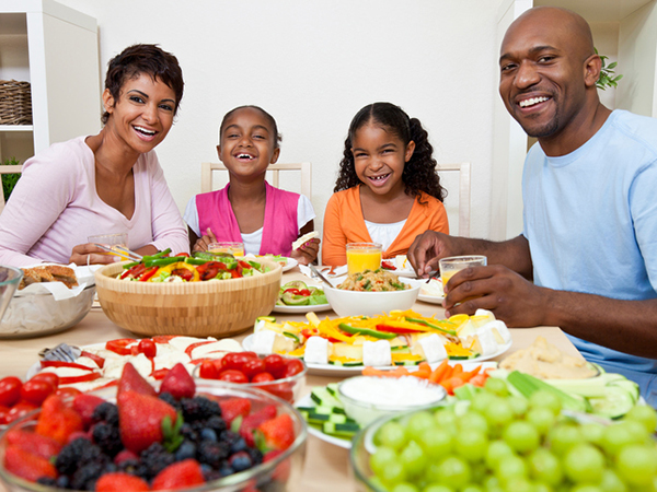 Family enjoying a healthy meal - Protect Your Health with Immune-Boosting Nutrition