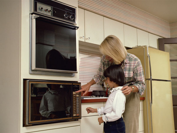 mom and son cooking in microwave